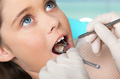 Picture of dental treatment with child